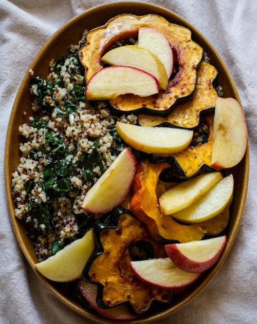 Roasted Acorn Squash and Apples with Quinoa, Kale, and Tahini Maple Dressing